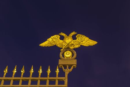 RUSSIA, SAINT PETERSBURG - January, 2017: double-Headed eagle of the Russian Empire on the grid of the Russian Museum Stock Photo