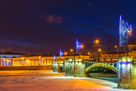 RUSSIA, SAINT-PETERSBURG - January, 2017: Christmas. View of the Spit of Vasilyevsky Island and Exchange Bridge