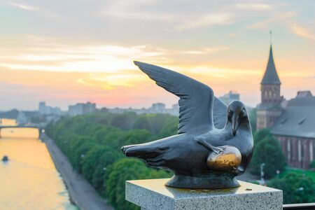 RUSSIA, KALININGRAD, - August, 2016: Kaliningrad. The sculpture Bird of happiness at the lighthouse Fishing village. The view of the Cathedral on Kant island