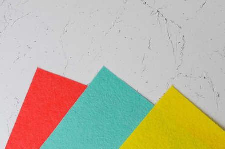 Mocap of colorful napkins on the textured surface of the table