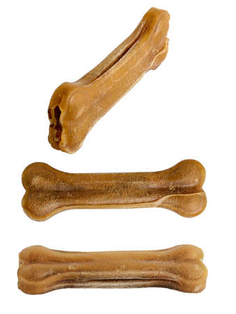Bone for a dog made of tendons and cartilage with the addition of vitamins and minerals necessary for the body of dogs. Isolated on white background.