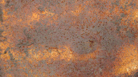 The texture of a rusty metal surface covered with dirt and multicolored rust. Background. Stock Photo