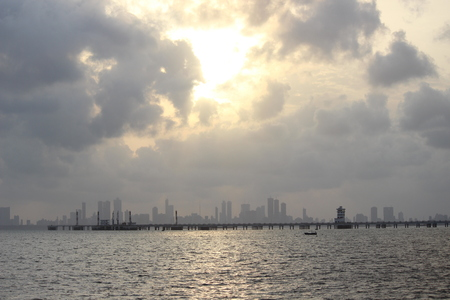 An evening look of Mumbai with a beautiful sunset and shining golden water