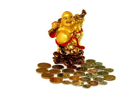 A figure of Buddha with coins on a white background. Stock Photo - 7428865