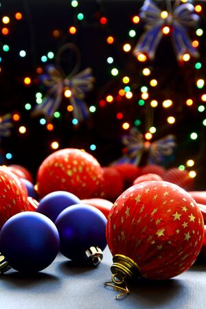Beautiful Christmas balls on the background lights Christmas tree garland.