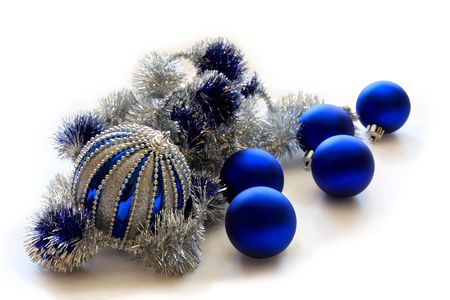 Blue Christmas balls with silver tinsel in isolation on a white background.