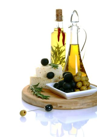Feta, black olives and green olives with rosemary on a white background.