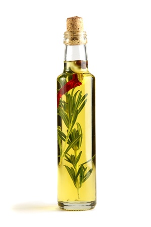 Olive oil with rosemary, garlic and pepper isolated on a white background.