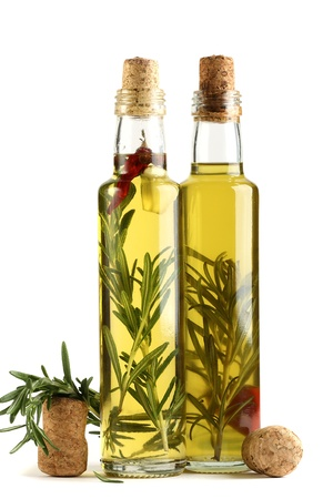 Olive oil with rosemary, garlic and pepper isolated on a white background. photo