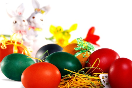 Easter bunnies and colored eggs on the background of spring colors. photo
