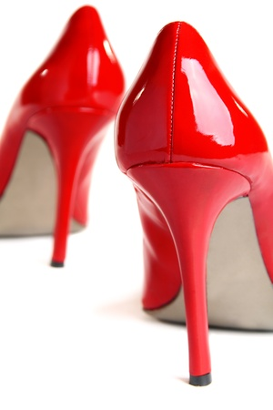 Red high-heeled shoes isolated on a white background.