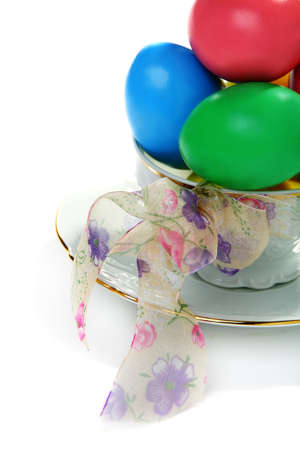 Easter eggs in a teacup isolated on a white background. photo