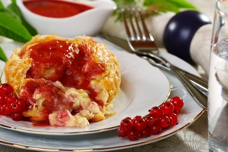 Cheese baked in puff pastry with berry sauce. Stock Photo - 10057191
