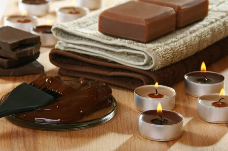 Sensuality spa chocolate aromatherapy items on a wooden table.  Stock Photo