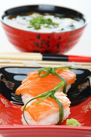 Salmon sushi close up in a ceramic dish. Stock Photo - 10263439