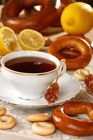 Tea with lemon and bagels on a linen napkin. photo