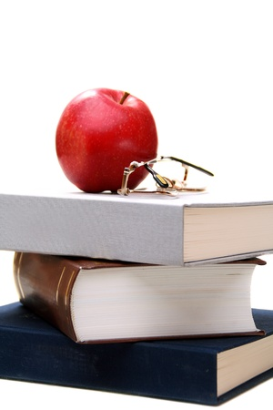 Stack of books and apple on a white background. photo