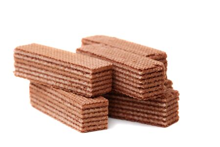 Chocolate wafers with cream filling on a white background. photo