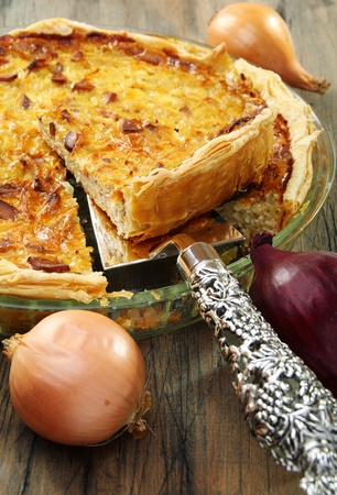 Alsatian onion pie with ham on wooden table. Stock Photo - 10824513