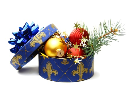 Christmas box with tinsel and balls on a white background.