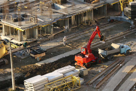 Construction site. View of the working excavator. photo