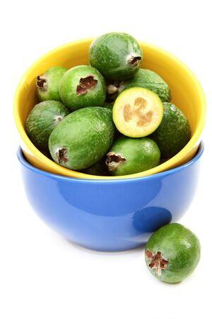 feijoa: Ripe feijoa fruit in bowl on a white background.