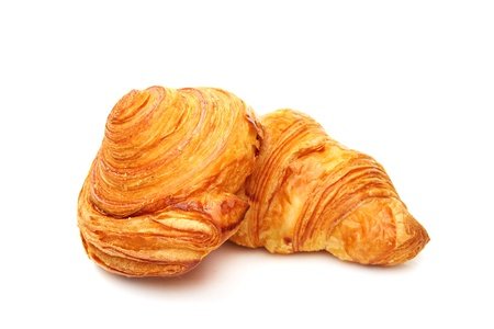 flaky: Rolls of puff pastry on a white background.