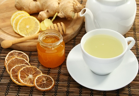 Ginger tea with honey and lemon on a bamboo napkin. Stock Photo - 11467899