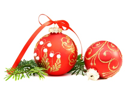 Christmas balls and a pine branch on a white background. photo