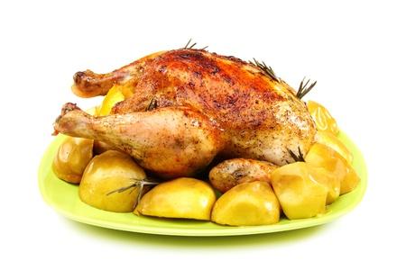Kurczak nadziewany z cytryny, jabłka i rozmaryn na białym tle. Zdjęcie Seryjne