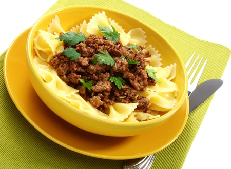Pasta with minced meat and herbs. Stock Photo