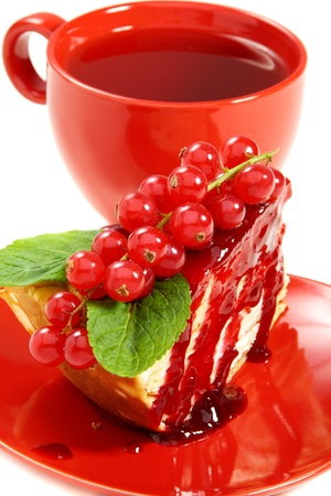 berry: Crepe cake and a red cup of tea on a white background.