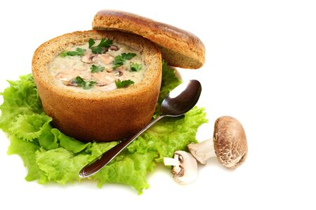 Potato soup with mushrooms on a white background.