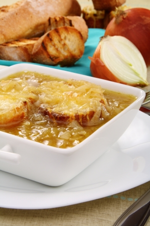 Onion soup with cheese croutons closeup