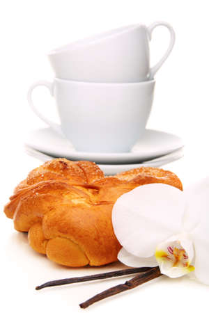 teaparty: Bun,vanilla and a flower on a white background.