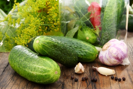 Cucumbers for pickling spices on a wooden table. Stock Photo