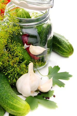 Cucumbers and spices for pickling on a white background.  Stock Photo