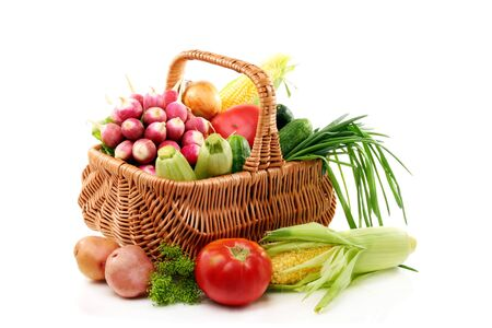 Vegetables in basket on a white background. Stock Photo - 14317294