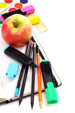 Notebook,pencils, paint and markers, back to school  On a white background  photo