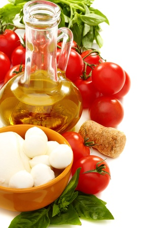Cheese, olive oil, tomatoes and basil on a white background   Stock Photo