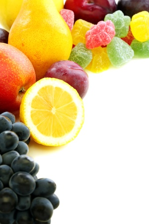 Summer fruits and marmalade on white background