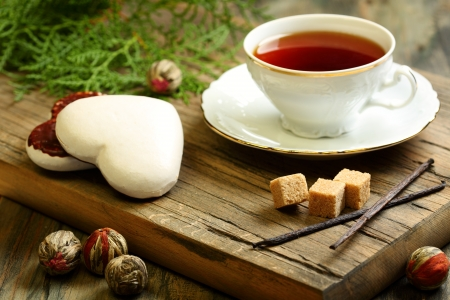 tea and biscuits: Spiced tea and ginger biscuits on a wooden table