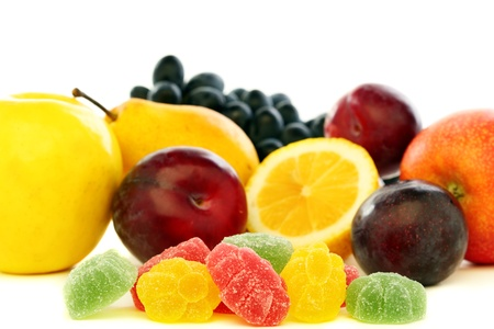 Colorful jelly and fresh fruit on a white background
