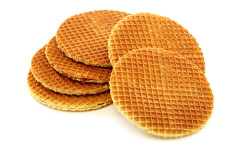 Round waffles with caramel filling on a white background