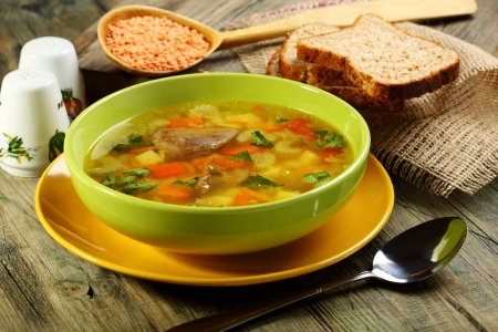 giblets: Soup of chicken giblets and red lentils in a green bowl  Stock Photo