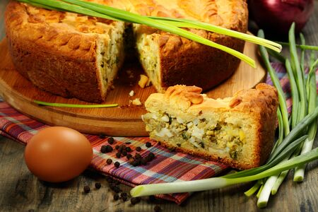 Pie stuffed with eggs and onions on a wooden table Stock Photo - 17007003