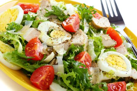 chicken egg: Salad with chicken, egg and tomato closeup  Stock Photo