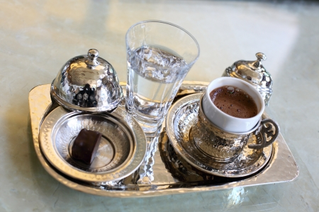 Turkish coffee in silver service and a glass of water