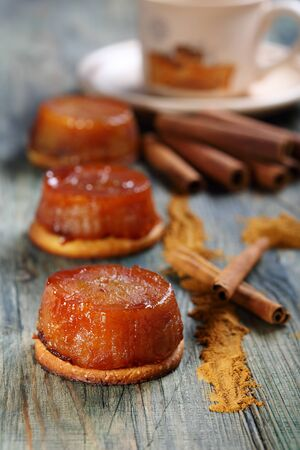 Tarte Tatin with apples and cinnamon on a wooden board