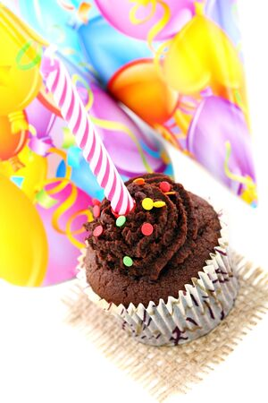Cupcake birthday and colorful caps on a white background  photo